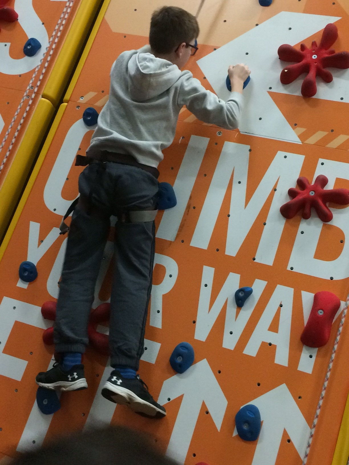 Image showing young boy rock climbing