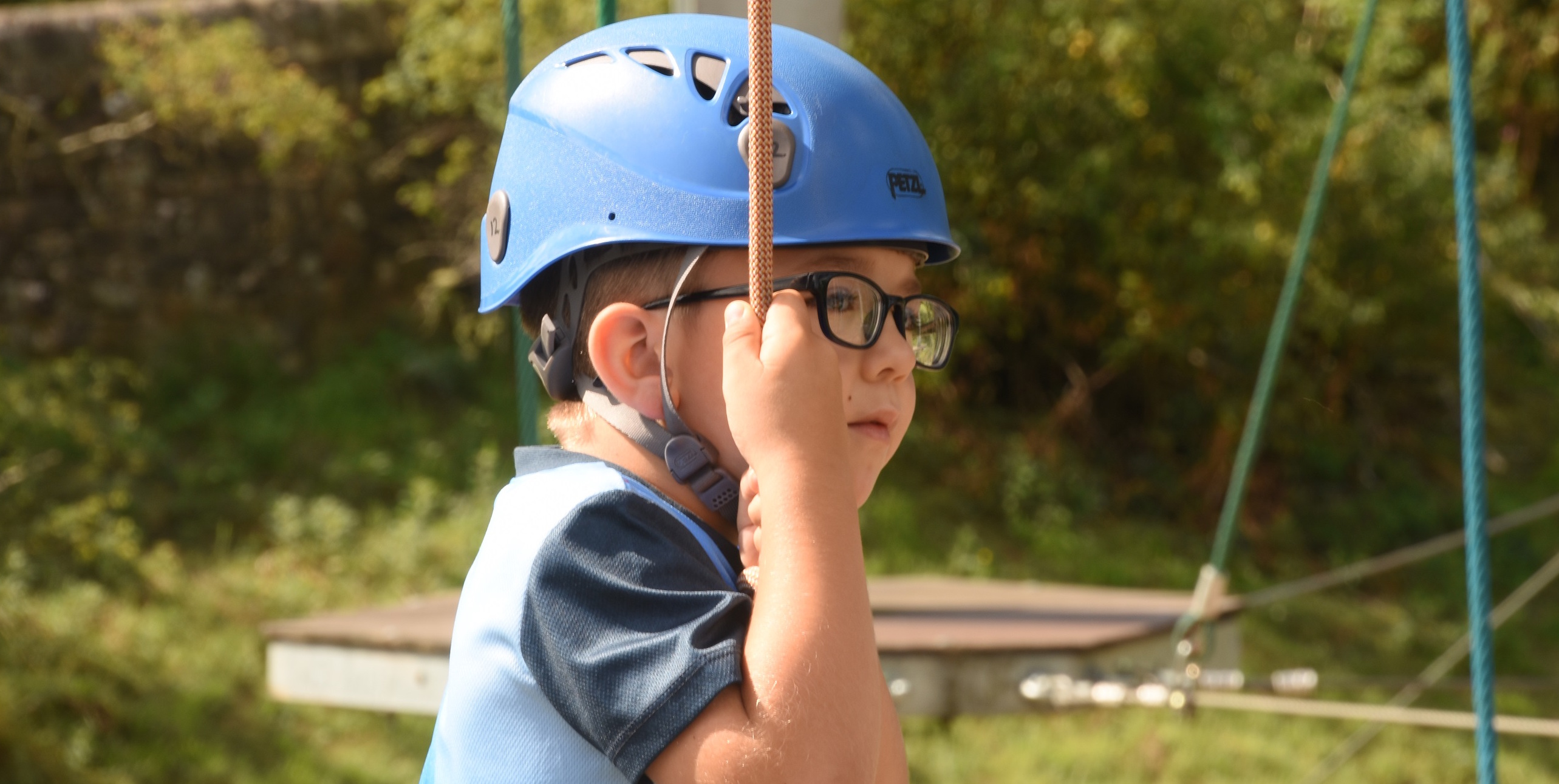 Image Showing a young boy wearing a safety helmet