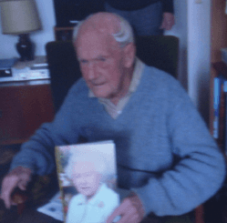 Image showing Leonard Burgoyne with his 100th birthday card from the Queen