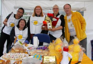Image showing Sight Support volunteers at a charity cake stall