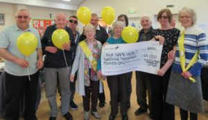 Image showing group of Sight Support volunteers holding a large cheque