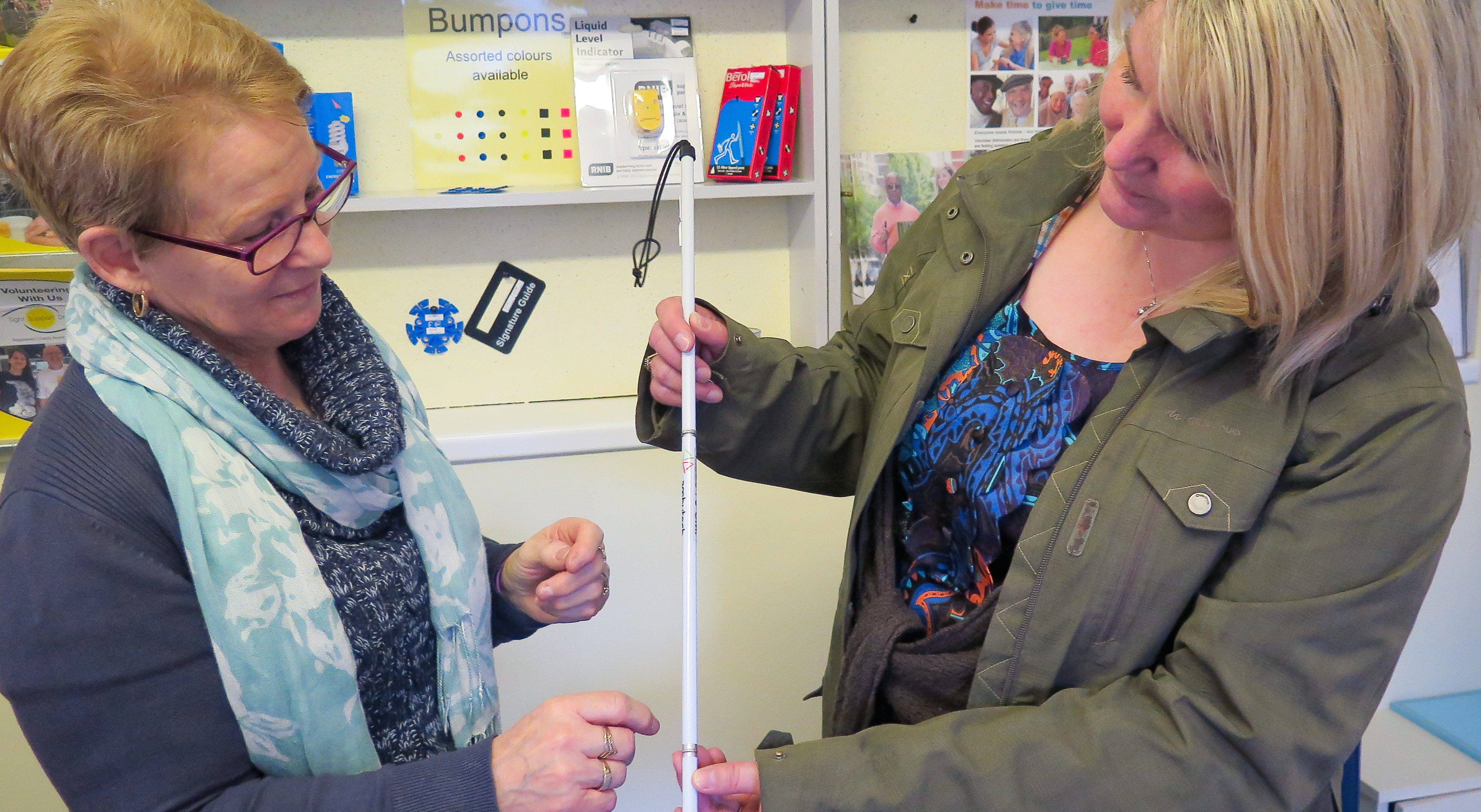 Image showing two women within the resource centre choosing a cane