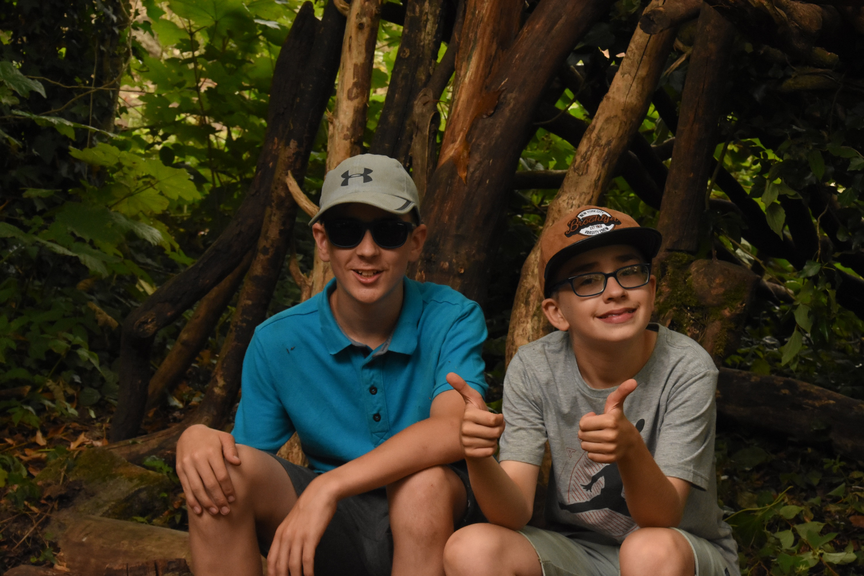 Image showing two young boys outdoors with thumbs up
