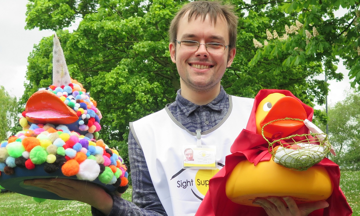 Image showing volunteer holding ducks at the duck race