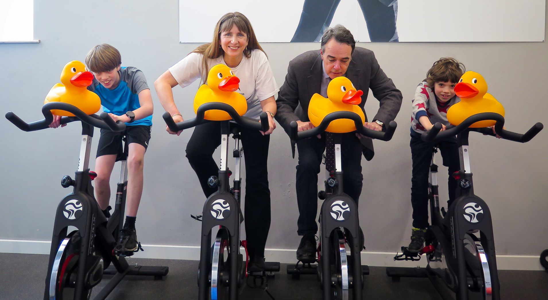 4 giant plastic ducks on top of 4 static bikes, pedalled by Oscar Burgess, Lynda Raven, Simon Leaf and Otis Burgess.