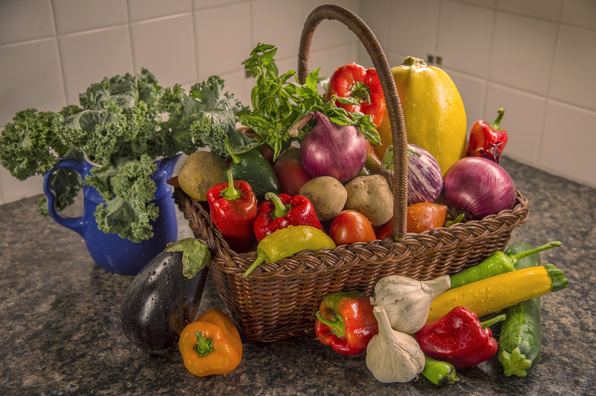 A basket of brightly coloured fresh fruit and vegetables
