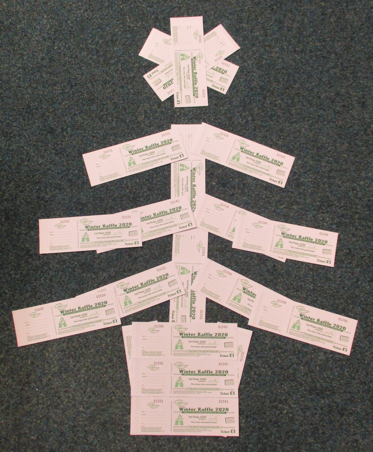 Books of raffle tickets arranged into a Christmas Tree