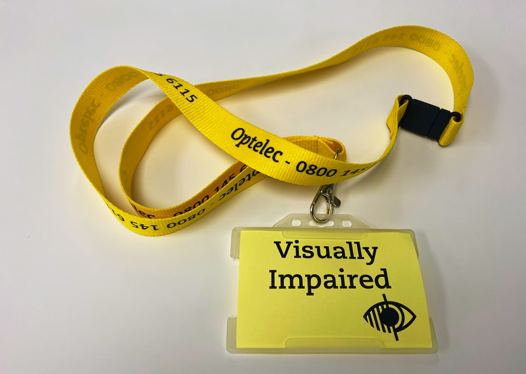 yellow card with visually impaired printed on it in large, black letters, with a yellow lanyard