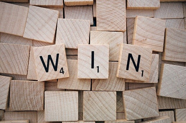 Scrabble letters spelling out the word Win